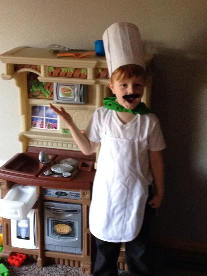 The chef hat, mustache, neckerchief, and apron all came from a class project at school so you know they didn't cost much.